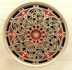 An intricate Venetian rose with a six-fold division of the circle in the Gothic style, as made in the late 16th century using layers of cypress wood reinforced with thin parchment